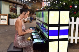 Myleene Klass plays the world's first tablet piano, made entirely from Samsung Galaxy Tab S2 tablets, in Spitalfields Market in east London. PRESS ASSOCIATION Photo. Picture date: Thursday December 10, 2015. Photo credit should read: Matt Crossick/PA Wire. The piano brings a Christmas tradition alive with the newest technology, and contains 106 of Samsung's latest Galaxy Tab S2 tablets.