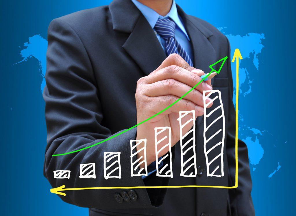photodune-1699487-businessman-hand-drawing-business-graph-m